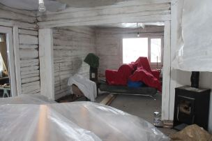 Log-cabin walls ready for insulation and boarding-out after 10 years as a slightly