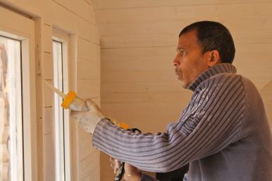 Glenn, my wonderful volunteer from New South Wales, getting stuck into the sticky stuff, sealing in the balcony door
