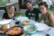 HelpX volunteers: Soyeon from South Korea, Shahar and Shani from Israel, presenting me with lunch of shakshuka, hummus and home-grown salad