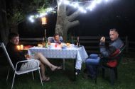 The reward of good food and good company under the mirabel tree: Marie, Hugues and Greg on a cool summer evening