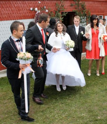 Alina led from the house by her attendants and her groom