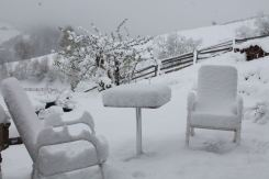 Thick snow on garden furniture