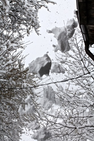 Snow lumps fall from roof